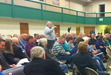 During a March 9 meeting about a proposed air park development, Leighton Township resident Dave Tubergen stands up to tell planning commissioners, 'I need you to protect my property. I need you to protect me.'