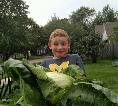 Hopkins Elementary third-grader Garett Lail shows his winning entry in the Bonnie Plants Big Cabbage Challenge.Photo provided to MLive by JoAnn Lail
