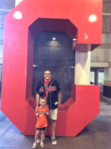 Cancer survivor Bekah Skrycki, of Wayland, 6, met bone marrow donor Anthony Colangelo at a Cleveland Indians game in September. Photo provided to MLive by Amy Skrycki