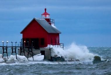 Waves crash onto Grand Haven's south pier Thursday, Feb. 25, 2016.