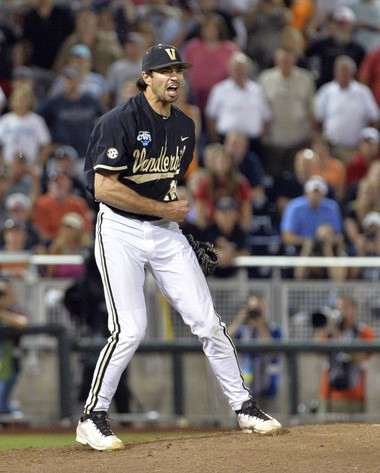 Adam Ravenelle celebrates the final out in the deciding game of College World Series.