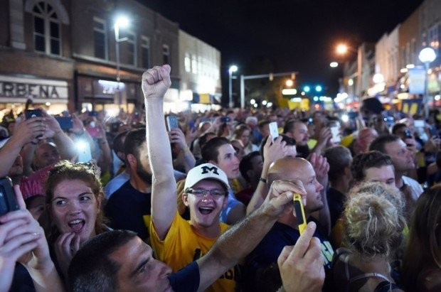 Fans flood State Street in downtown Ann Arbor for Michigan's Nike launch.