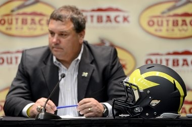Michigan coach Brady Hoke addresses the media before the Outback Bowl -- a game his team lost against South Carolina.