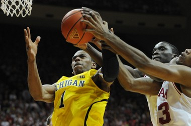 Michigan freshman forward Glenn Robinson III goes up for a rebound Saturday against Indiana's Victor Oladipo at Assembly Hall in Bloomington, Ind.
