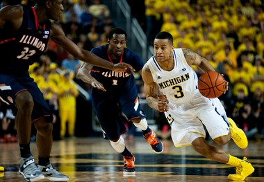 Michigan point guard Trey Burke drives to the basket during a win over Illinois earlier this season.