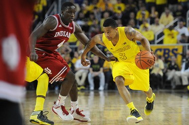 Michigan point guard Trey Burke drives against Indiana junior Victor Oladipo on Sunday at the Crisler Center.