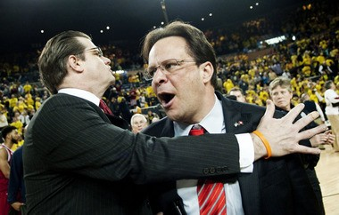 Indiana coach Tom Crean is restrained by a staffer Sunday following the Hoosiers' 72-71 win over Michigan at the Crisler Center.