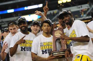 Most Outstanding Player Trey Burke celebrates Michigan's South Regional title, and berth into the Final Four.