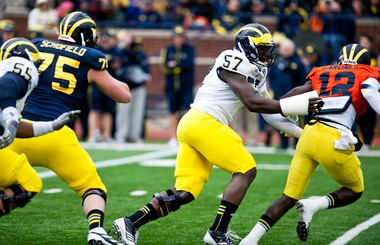 """Michigan defensive end Frank Clark wasn't allowed to tackle the quarterbacks during the spring game Saturday, but did track down Devin Gardner here for a """"touch sack."""""""