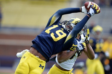 Tight end Devin Funchess, shown making a leaping grab during the spring game, led Michigan in touchdown catches last year. The Wolverines plan to use their tight ends more going forward, which helped lure TE recruit Ian Bunting to Ann Arbor.