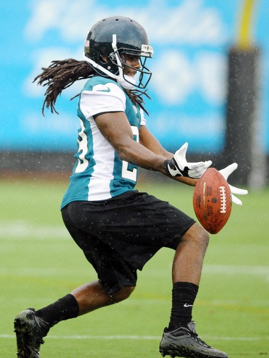 Denard Robinson tries to make a play Friday during the first day of Jacksonville's rookie minicamp.