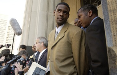 Chris Webber stands outside federal court in Detroit on Sept. 16, 2003.