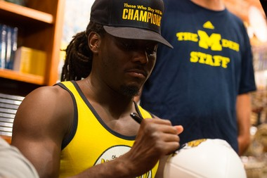 Denard Robinson profited from a recent autograph session at the MDen, where fans began lining up more than five hours before his arrival. He's a hugely marketable player -- but couldn't cash in until he concluded his career at Michigan.