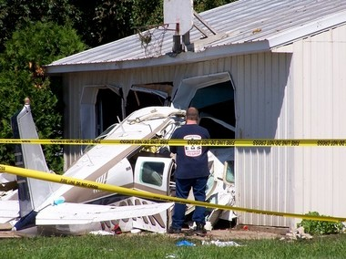 Investigators at the scene in Charlevoix, Mich., site of the June 2011 plane crash that killed Dr. Stephen Hatch and his wife, Kim, and left Michigan basketball recruit Austin Hatch in critical condition.