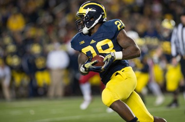 Former Michigan running back Fitz Toussaint will attend rookie camp with the Baltimore Ravens.