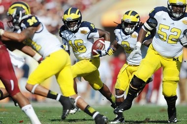 Michigan may have looked a tad goofy in the Outback Bowl last season, but it was paid well for it.