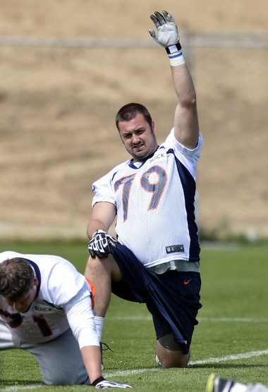 """Former Michigan offensive lineman Michael Schofield has reportedly been """"impressive early"""" during organized team activities with the Denver Broncos this week."""