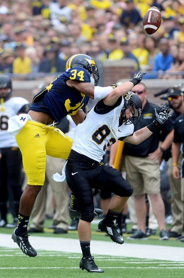 Jeremy Clark breaks up a pass intended for Appalachian State wide receivers Simms McElfresh during the Wolverines' season opener on Saturday, August 30, 2014.