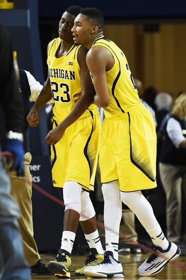 Michigan sophomore guard Zak Irvin, seen here helping teammate Caris LeVert off the floor after he suffered a season-ending foot fracture on Saturday, is averaging 13.9 points, but shooting 35.7 percent on 3-point attempts.