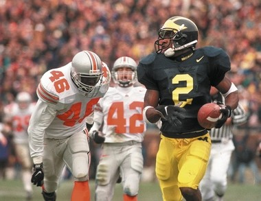 The Nike swoosh was a staple of the Michigan uniforms worn by Charles Woodson and the Wolverines of the mid-to-late 1990s.