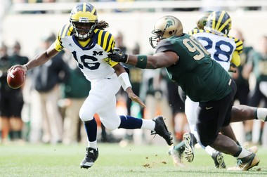 Michigan experimented with some alternate uniforms during its 2008-2015 contract with Adidas, such as this look worn by quarterback Denard Robinson against Michigan State in 2011. Some were well received. Others were not.