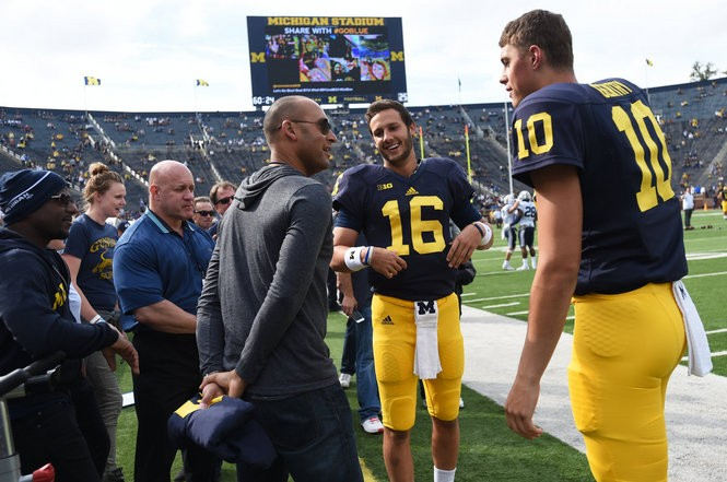 d6fc8d2a669 Former New York Yankee Derek Jeter chats with Michigan quarterback Garrett  Moores (16) and