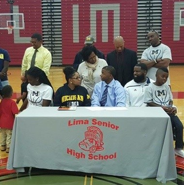Lima Senior High School point guard Xavier Simpson signed his National Letter of Intent to Michigan during a signing ceremony in the Lima gymnasium on Nov. 11, 2015.