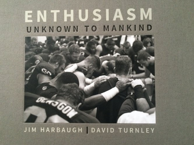 """The cover of """"Enthusiasm Unknown to Mankind,"""" a book produced by photographer David Turnley and Michigan coach Jim Harbaugh."""
