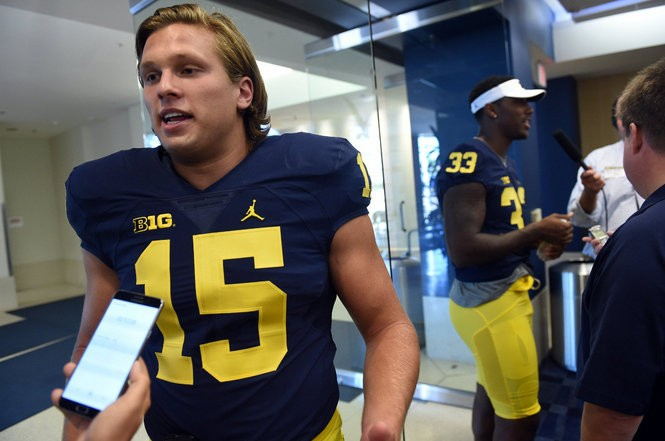 Michigan defensive end Chase Winovich speaks with reporters during media day at Junge Family Champions Center on Sunday, August 7, 2016.