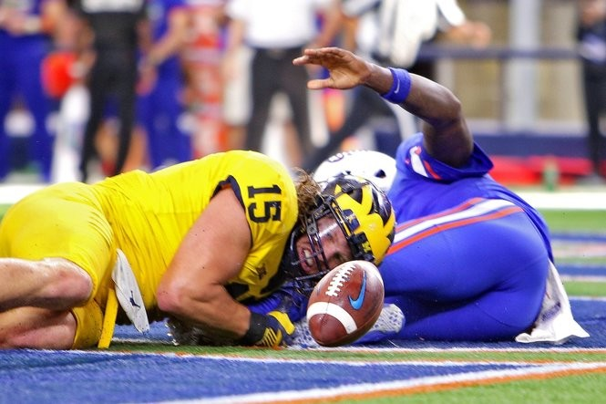 Michigan defensive lineman Chase Winovich (15) looks to the ball after forcing a fumble by Florida quarterback Malik Zaire (8) in the end zone in the fourth quarter of their college football game against Florida at AT&T Stadium in Arlington, on Saturday, September 2, 2017.