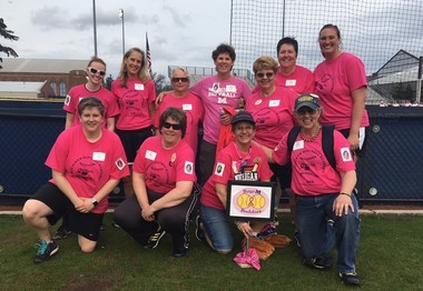 """The """"Bosom Buddies"""" fundraising team poses for a photo at the ninth annual Michigan Softball Academy on Thursday, May 3. (Ryan Zuke 