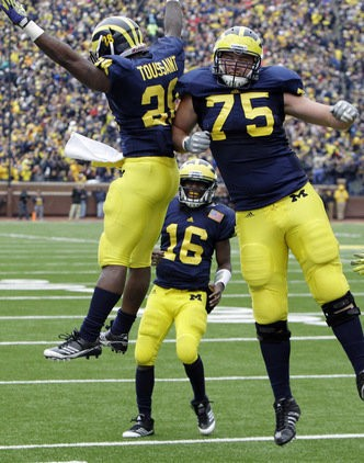 Former Michigan right tackle Michael Schofield (right) has drawn praise this week at the annual Senior Bowl.