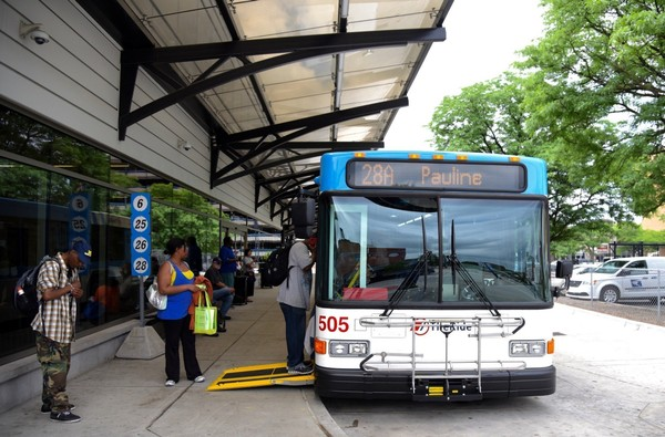 AAATA riders board a bus at the Blake Transit Center in downtown Ann Arbor.