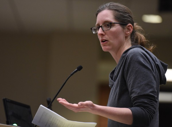 Jessica Prozinski, an organizer with a grassroots group called Stop Trump Ann Arbor, speaks at the Ann Arbor City Council meeting on Tuesday, Feb. 21, 2017.