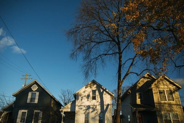 Homes along Oakland Avenue SW in the Roosevelt Park neighborhood of Grand Rapids on Monday, Nov. 21, 2016.