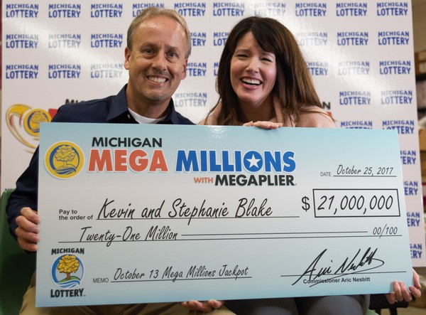 Kevin and Stephanie Blake of Waterford won $21 million after splitting a $42 million Mega Millions jackpot for the drawing held on Friday, Oct. 13, 2017. The lucky couple says they plan on continuing to work, despite winning such a large amount of money.