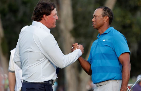 Why do we have to pay to watch Phil Mickelson and Tiger Woods play? (Lynne Sladky | AP Photo)