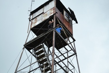 Paul DeLucia, left, of Baldwinsville, near the top of the fire tower on the top of Woodhull Mountain.