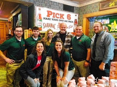 Actor Kelsey Grammer poses with staff members at the F.X. Matt (Saranac) brewery in Utica during a visit last fall.