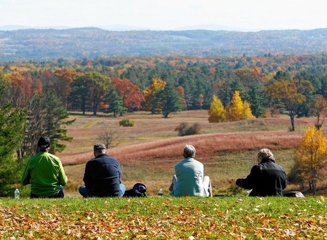 Visitors to Saratoga National Historical Park look over a Revolutionary War battlefield in Stillwater, N.Y.