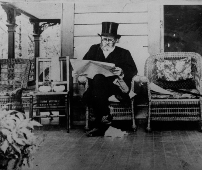 General Ulysses S. Grant, the 18th President of the U.S., reads on the porch of Drexel Cottage near Saratoga Springs, N.Y. on July 20, 1885. He died of throat cancer 3 days later.
