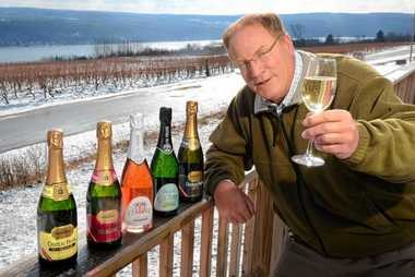 Fred Frank, owner of Chateau Frank in Hammondsport, N.Y. with a selection of the sparkling wines they make. The deck of the tasting room overlooks the vineyards and Keuka Lake.