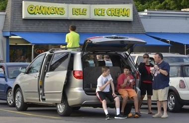 Mark and Diane Schulman, DeWitt with sons Max (on gthe roof of van), and Hal, seated right, and the boys friend Eric Antosh, seated left, at Gannon's Isle, 1525 Valley Drive, Syracuse. Tuesday, May 27, 2014. Gary Walts | gwalts@syracuse.com