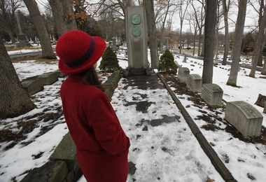 In this photo taken Feb. 23, 2010, Barbara Snedecor, director of Elmira College's Center for Mark Twain Studies, shows the the Mark Twain grave in Woodlawn Cemetery in Elmira, N.Y.