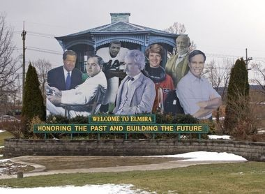 This Church Street sign features native and adopted Elmirans, from left, Brian Williams, Hal Roach, Ernie Davis, Mark Twain, Eileen Collins, John W. Jones and Tommy Hilfiger.