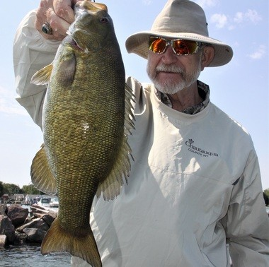 Dave Barus of East Aurora, N.Y. with a 20-inch smallmouth bass he caught fishing in the Dunkirk Harbor on Lake Erie.