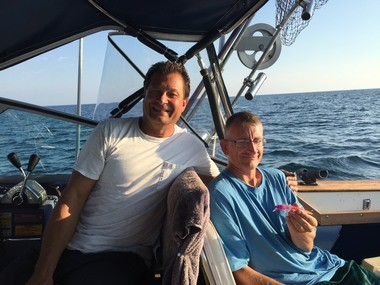 "Capt. Joel Rugierio, left, and his first mate, Jeffrey Rasmus, who Ruggiero calls ""The Rain Man of Lake Erie."""