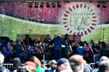 Opening day of the Rochester Lilac Festival at Highland Park, Rochester, N.Y., Friday May 6, 2016. Rochester School of the Arts concert band performs.