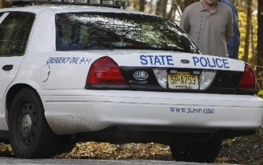 State Police are investigating a shooting in the woods behind a Port Norris residence that left four people wounded.