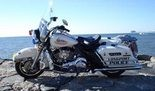 A Longport police officer fired for cracking a windshield on a patrol car has been reinstated.